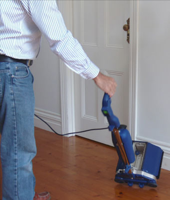 Transportable and portable compact sized floor cleaner