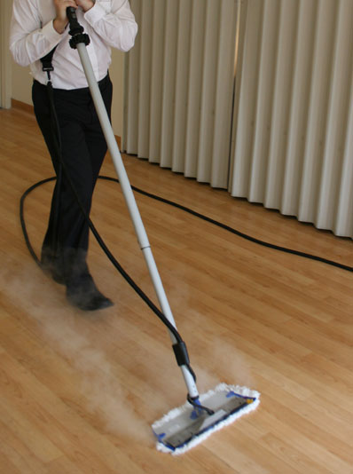 Steam mopping the flooring surfaces